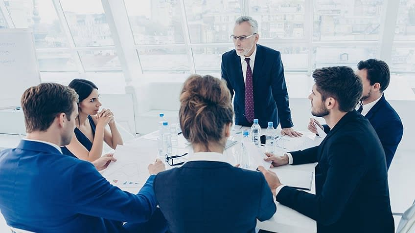 Why should you conduct Project Status Meetings with your team?